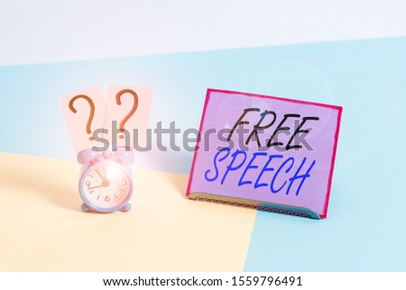 Word writing text Free Speech. Business concept for the right of showing to express their opinions publicly Mini size alarm clock beside a Paper sheet placed tilted on pastel backdrop.