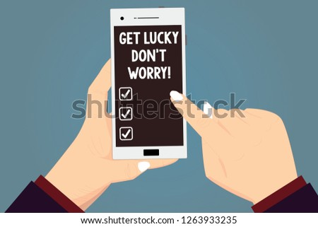 Word writing text Get Lucky Don T Worry. Business concept for Stop worrying and have a good fortune luck success Hu analysis Hands Holding Pointing Touching Smartphone Blank Color Screen.