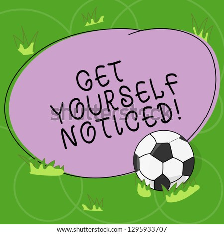 Word writing text Get Yourself Noticed. Business concept for to be or become obvious or noticeable Stand out Soccer Ball on the Grass and Blank Outlined Round Color Shape photo.