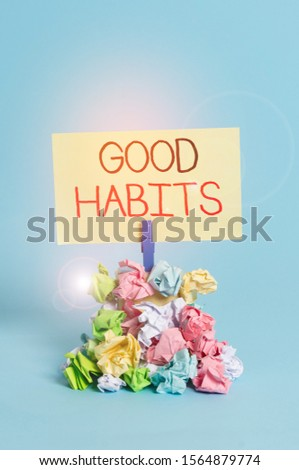 Word writing text Good Habits. Business concept for behaviour that is beneficial to one s is physical or mental health Reminder pile colored crumpled paper clothespin reminder blue background.