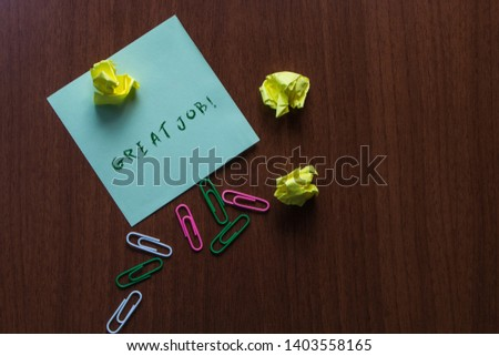 Word writing text Great Job. Business concept for used praising someone for something they have done very well Upper view three small paper balls colored clips stick pad wooden table. #1403558165