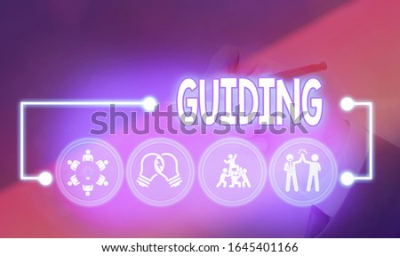 Word writing text Guiding. Business concept for to show someone how to do something difficult Indicate the way.
