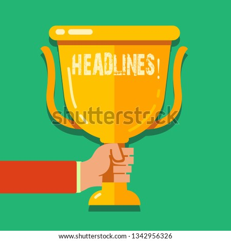 Word writing text Headlines. Business concept for Heading at the top of an article in newspaper Hand Holding Blank Golden Championship Winners Cup Trophy with Reflection.