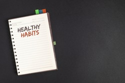 Word writing text Healthy Habits. Business concept for Good nutrition diet take care of oneself Weight Control Text two Words notes written white notepad black pen pink desk school work