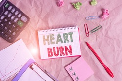 Word writing text Heart Burn. Business concept for a burning sensation or pain in the throat from acid reflux Papercraft craft paper desk square spiral notebook office study supplies.
