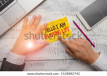 Word writing text Hello I Am Enjoying Life. Business concept for Happy relaxed lifestyle Enjoy simple things.