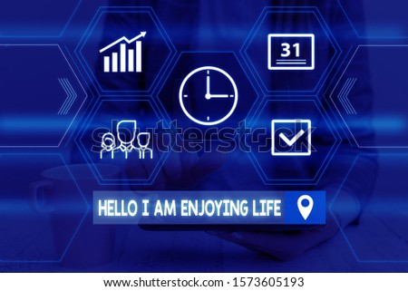 Word writing text Hello I Am Enjoying Life. Business concept for Happy relaxed lifestyle Enjoy simple things Woman wear formal work suit presenting presentation using smart device. #1573605193