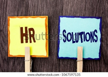 Word writing text Hr Solutions. Business concept for Recruitment Solution Consulting Management Solving Onboarding written on Sticky Note Papers Holding with Wooden Clip on the wooden background.