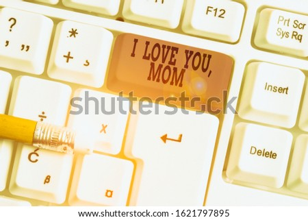 Word writing text I Love You Mom. Business concept for Loving message emotional feelings affection warm declaration White pc keyboard with empty note paper above white background key copy space.