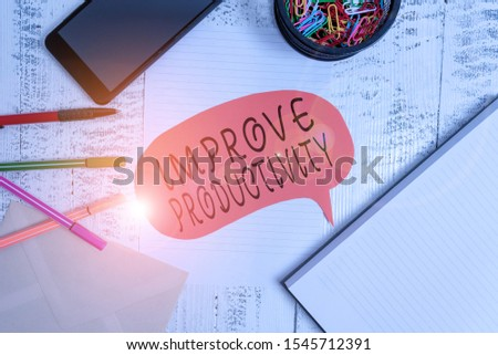 Word writing text Improve Productivity. Business concept for to increase the machine and process efficiency Smartphone pens envelope clips speech bubble sheet notebook wooden back.