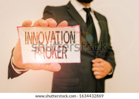 Word writing text Innovation Broker. Business concept for help to mobilise innovations and identify opportunities Male human wear formal work suit office look hold notepaper sheet use hand.