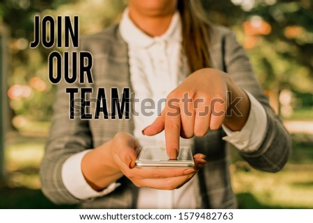 Word writing text Join Our Team. Business concept for Hiring Vacancy Huanalysis resource recruitment Manpower hunt Woman in grey suites holds mobile phone. #1579482763
