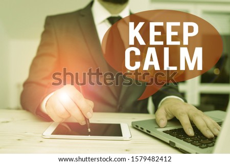 Word writing text Keep Calm. Business concept for not get emotionally invested in situations you cannot control over Male human wear formal clothes present presentation use hi tech smartphone.