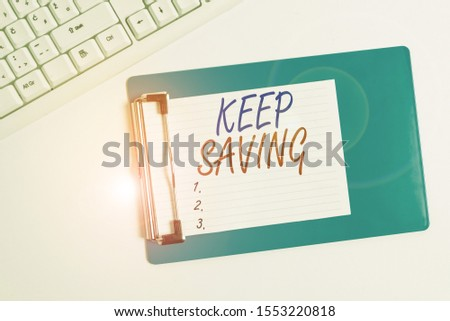 Word writing text Keep Saving. Business concept for keeping money in an account in a bank or financial organization Flat lay above table with pc keyboard and copy space note paper.