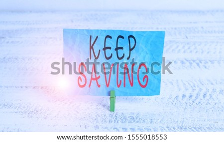 Word writing text Keep Saving. Business concept for keeping money in an account in a bank or financial organization Green clothespin white wood background colored paper reminder office supply.