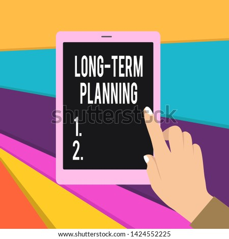 Word writing text Long Term Planning. Business concept for Establish Expected Goals five or more years ahead Female Hand with White Polished Nails Pointing Finger Tablet Screen Off.