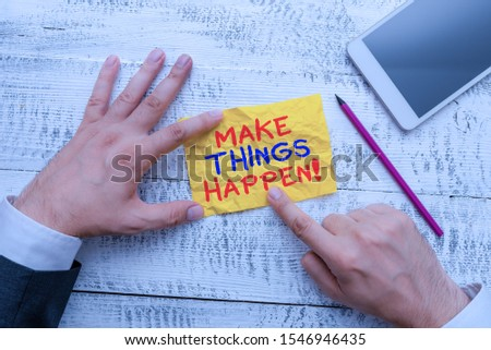 Word writing text Make Things Happen. Business concept for you will have to make hard efforts in order to achieve it Hand hold note paper near writing equipment and modern smartphone device.