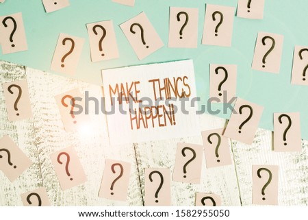 Word writing text Make Things Happen. Business concept for you will have to make hard efforts in order to achieve it Scribbled and crumbling papers with thick cardboard above wooden table.