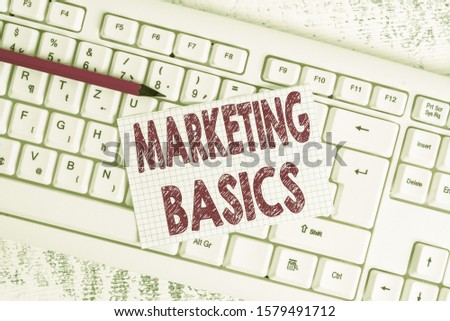 Word writing text Marketing Basics. Business concept for activities a company takes to promote and sell products White keyboard office supplies empty rectangle shaped paper reminder wood.