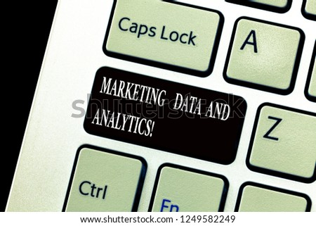 Word writing text Marketing Data And Analytics. Business concept for Advertising promotion statistical analysis Keyboard key Intention to create computer message, pressing keypad idea. #1249582249