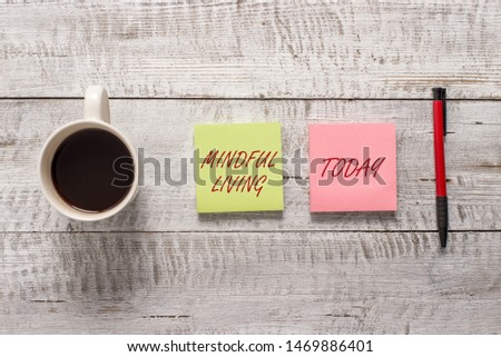 Word writing text Mindful Living. Business concept for Fully aware and engaged on something Conscious and Sensible Stationary placed next to a cup of black coffee above the wooden table. #1469886401