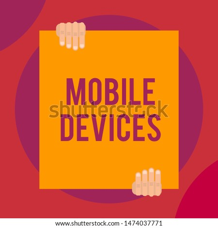 Word writing text Mobile Devices. Business concept for A portable computing device like smartphone tablet computer Two hands holding big blank rectangle up down Geometrical background design.