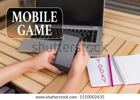 Word writing text Mobile Game. Business concept for they are entertaining programs made to work on smart device woman laptop computer smartphone office supplies technological devices. #1510002635
