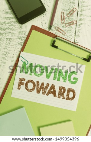 Word writing text Moving Foward. Business concept for Towards a Point Move on Going Ahead Further Advance Progress Clipboard sheet pencil smartphone note clips notepads wooden background.