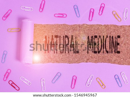 Word writing text Natural Medicine. Business concept for any of various systems of healing or treating disease Paper clip and torn cardboard placed above a wooden classic table backdrop. #1546945967