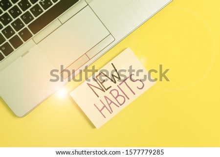 Word writing text New Habits. Business concept for change the routine of behavior that is repeated regularly Slim trendy silver open laptop square sticky notepad colored background.