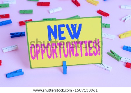 Word writing text New Opportunities. Business concept for exchange views condition favorable for attainment goal Colored clothespin papers empty reminder pink floor background office pin.