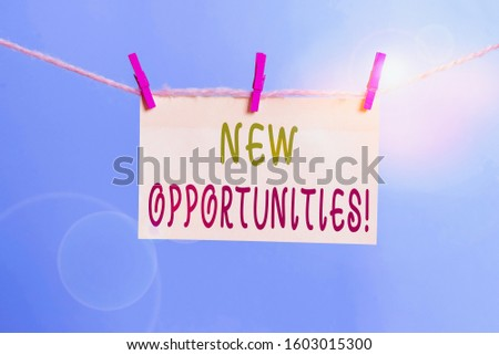 Word writing text New Opportunities. Business concept for exchange views condition favorable for attainment goal Clothesline clothespin rectangle shaped paper reminder white wood desk.