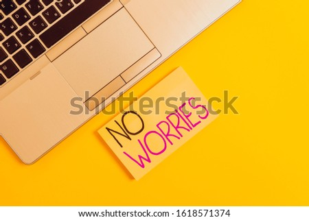Word writing text No Worries. Business concept for an expression used to say that everything is all right Slim trendy silver open laptop square sticky notepad colored background.