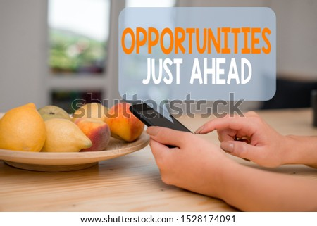 Word writing text Opportunities Just Ahead. Business concept for Advantageous circumstances Perseverance pays off woman using smartphone office supplies technological devices inside home.