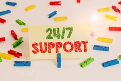 Word writing text 24 Or 7 Support. Business concept for twentyfour hours seven days a week support to client Colored clothespin papers empty reminder white floor background office.