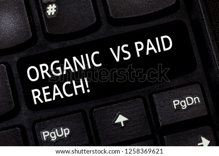 Word writing text Organic Vs Paid Reach. Business concept for Increasing followers naturally or by paying for it Keyboard key Intention to create computer message pressing keypad idea.