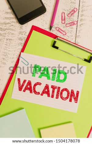 Word writing text Paid Vacation. Business concept for Sabbatical Weekend Off Holiday Time Off Benefits Clipboard sheet pencil smartphone note clips notepads wooden background.