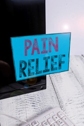 Word writing text Pain Relief. Business concept for Drugs or other methods of reducing or getting rid of pain Notation paper taped to black computer monitor screen near white keyboard.