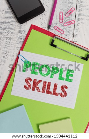 Word writing text People Skills. Business concept for Get Along well Effective Communication Rapport Approachable Clipboard sheet pencil smartphone note clips notepads wooden background.