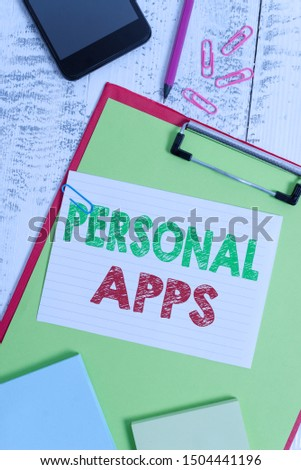 Word writing text Personal Apps. Business concept for Organizer Online Calendar Private Information Data Clipboard sheet pencil smartphone note clips notepads wooden background.