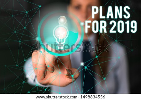 Word writing text Plans For 2019. Business concept for an intention or decision about what one is going to do Female human wear formal work suit presenting presentation use smart device. #1498834556