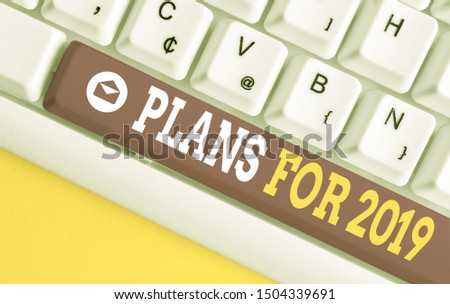 Word writing text Plans For 2019. Business concept for an intention or decision about what one is going to do White pc keyboard with empty note paper above white background key copy space. #1504339691