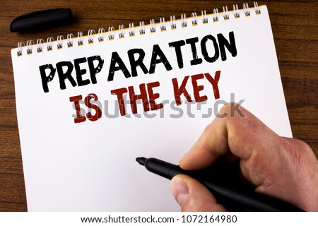Word writing text Preparation Is The Key. Business concept for Learn Study Prepare yourself for achieving success written by Man Notepad holding Marker the Wooden background.
