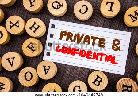 Word, writing, text  Private And Confidential. Conceptual photo Security Secret Sensitive Classified Information written on tear notobook paper on wooden background with letters.