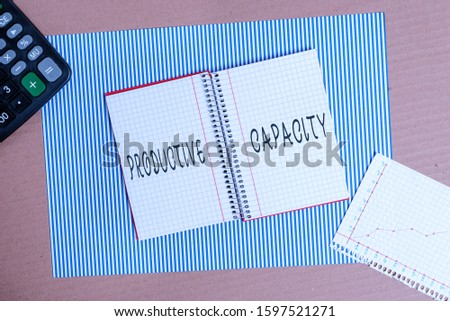 Word writing text Productive Capacity. Business concept for the maximum possible output of a production plant Striped paperboard notebook cardboard office study supplies chart paper.