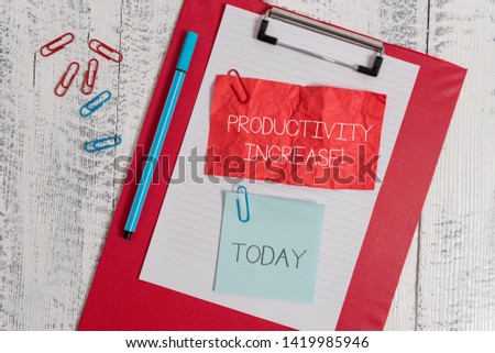 Word writing text Productivity Increase. Business concept for get more things done Output per unit of Product Input Clipboard paper sheet crushed sticky note clip marker wooden background. #1419985946