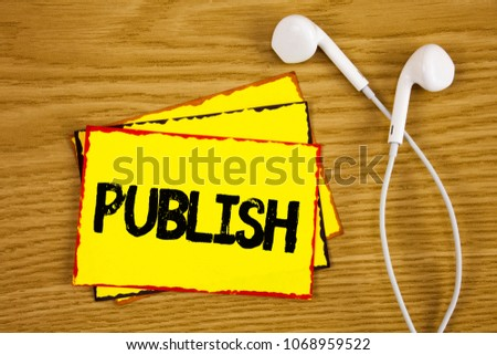 Word writing text Publish. Business concept for Make information available to people Issue a written product written on Yellow Sticky Note Paper on wooden background Handsfree next to it. #1068959522