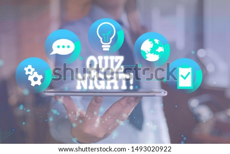 Word writing text Quiz Night. Business concept for evening test knowledge competition between individuals Female human wear formal work suit presenting presentation use smart device.