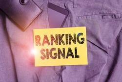 Word writing text Ranking Signal. Business concept for characteristic of a website that search engine algorithms Smartphone device inside trousers front pocket with wallet and note paper.