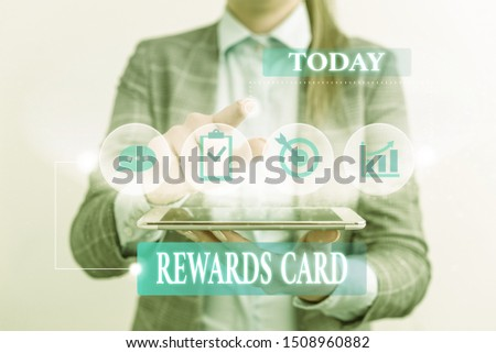 Word writing text Rewards Card. Business concept for Help earn cash points miles from everyday purchase Incentives Female human wear formal work suit presenting presentation use smart device. #1508960882